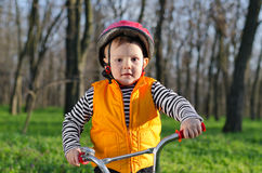 Little boy playing with his bicycle Royalty Free Stock Photos