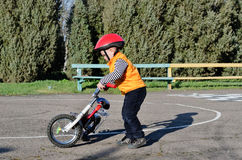 Little boy playing with his bike Stock Photography