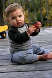 Little Boy Playing with his Car. A little boy playing outside with his little toy car Stock Photography