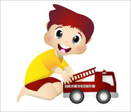 Little boy playing with his fire truck toys. Little boy with yellow clothes playing with his fire truck toys Stock Images
