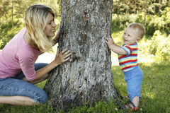 Little boy playing with his mother in nature Stock Images