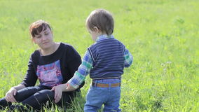Little boy playing with his mother in nature. stock footage