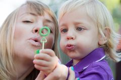 Mom and her baby boy blowing bubbles Royalty Free Stock Photo