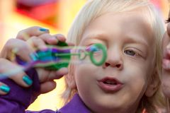 Baby boy and his mom blowing bubbles Stock Photo