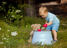 Little boy playing with his teddy bear Royalty Free Stock Photos