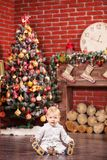 Little boy playing with his toy by Christmas tree Stock Image