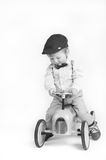 Little boy playing with his toy tractor Royalty Free Stock Images