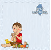 Little boy are playing with his toys. On his first birthday Royalty Free Stock Photo