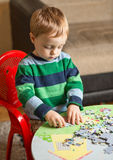 Little boy playing at home Stock Photos