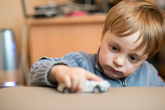 Little boy playing at home Stock Photo