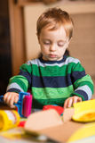 Little boy playing at home Stock Photography