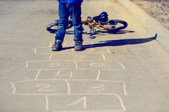 Little boy playing hopscotch Royalty Free Stock Images
