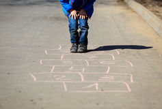 Little boy playing hopscotch Royalty Free Stock Photos