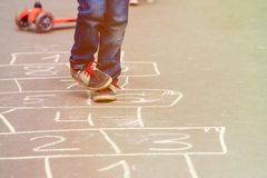 Little boy playing hopscotch outdoors Royalty Free Stock Image