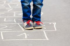 Little boy playing hopscotch outdoors Royalty Free Stock Images