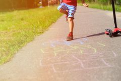 Little boy playing hopscotch on playground Royalty Free Stock Image