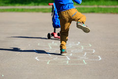 Little boy playing hopscotch on playground Stock Image