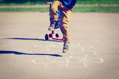 Little boy playing hopscotch on playground Royalty Free Stock Images
