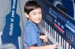 Little boy playing keyboard at music room Royalty Free Stock Photos