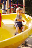 Little boy playing in a kids playground royalty free stock photos