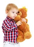 Little boy is playing in the kindergarten with a. Teddy bear.Early years learning a happy childhood concept.Isolated on white background Stock Images