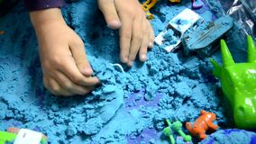 Little boy Playing with Kinetic Sand at Home Early Education Preparing for School Development Children Game. digs sand stock video