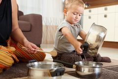 Little boy playing in kitchen Royalty Free Stock Photography