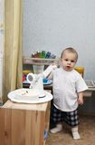 Little boy playing kitchen Royalty Free Stock Photo