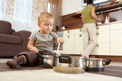 Little boy playing in kitchen Stock Image