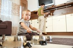 Little boy playing in kitchen royalty free stock photo