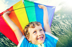 Little Boy Playing Kite Park Windy Concept Stock Image