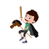 Little boy playing knight with a hobby horse and a sword Royalty Free Stock Image