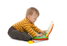 Little boy playing with laptop Stock Photo