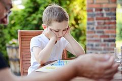 Little boy playing ludo board game Royalty Free Stock Images