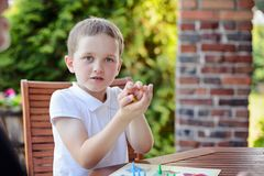 Little boy playing ludo board game Stock Images