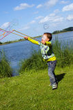 Little boy playing with magic bubbles. Little boy playing with magical bubbles on the lake Stock Photos