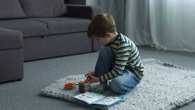 Little boy playing with magnetic constructor toy stock video