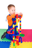 Little boy playing with the marble run Stock Image