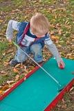 Little boy playing mini-golf Stock Image