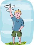 Little boy playing with model airplane Royalty Free Stock Photo