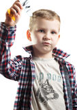 Little boy playing with a model airplane pretending to be a pilot Stock Photography