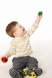 The little boy playing with New Year's toys Stock Image