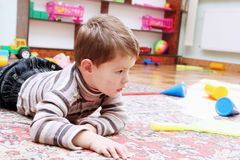 Little Boy Playing in Nursery Royalty Free Stock Photos