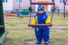 Little boy playing outdoor on city playground Royalty Free Stock Image