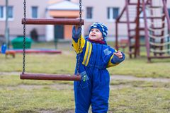 Little boy playing outdoor on city playground Stock Images