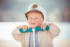 Little boy playing outdoor on the pier Royalty Free Stock Photography