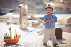 Little boy playing outdoor on the pier Royalty Free Stock Images