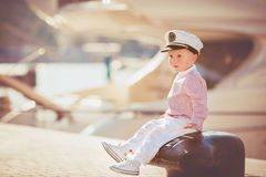 Little boy playing outdoor on the pier Stock Photos