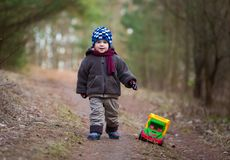 Little boy playing outdoor with a toy car. Stock Photo