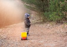 Little boy playing outdoor with a toy car. Stock Images